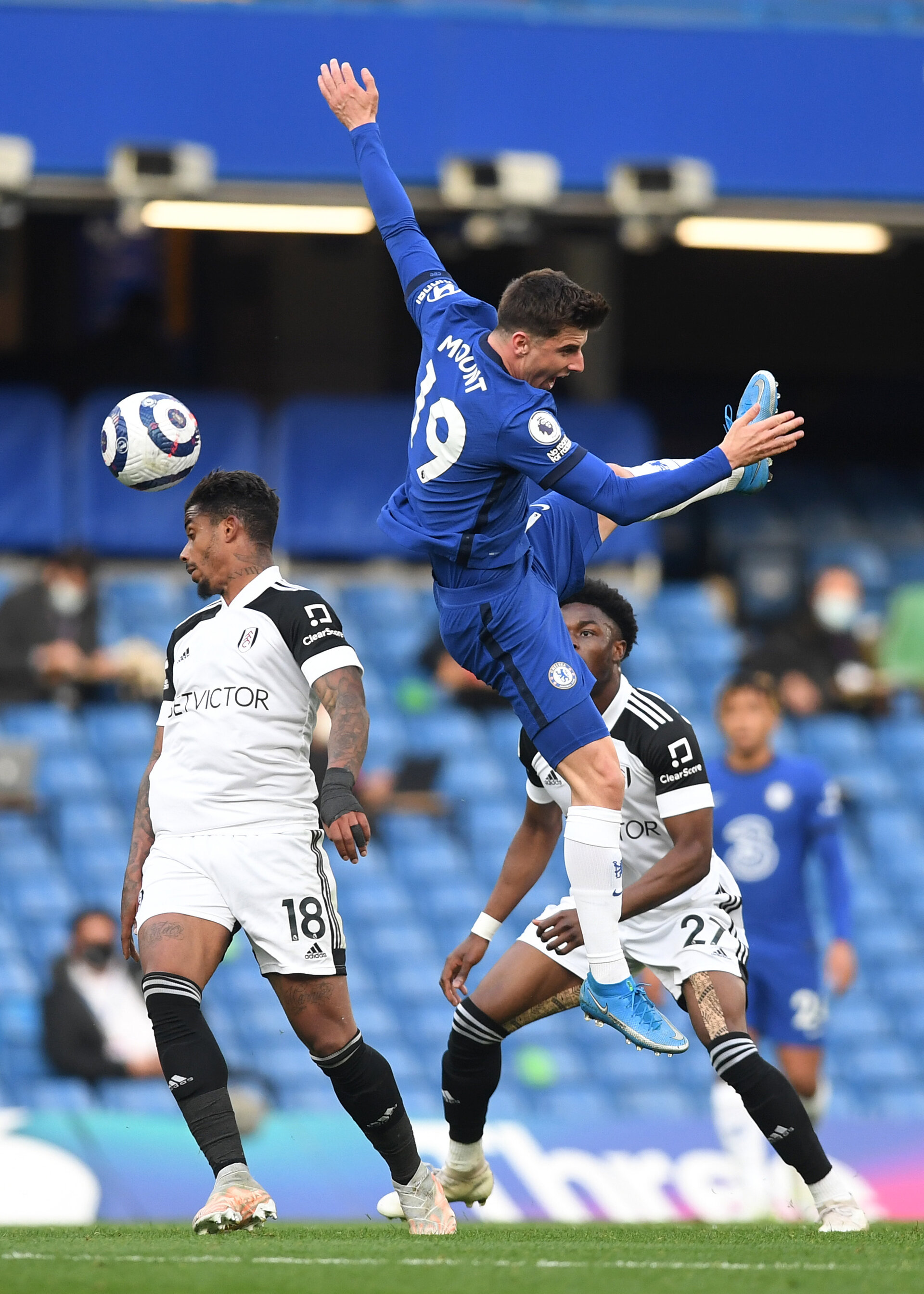 LONDON, ENGLAND - MAY 01: Mason Mount of Chelsea battles for possession with Mario Lemina (L) and Josh Maja (R) of Fulham and lands awkwardly requiring medical treatment during the Premier League match between Chelsea and Fulham at Stamford Bridge on May 01, 2021 in London, England. Sporting stadiums around the UK remain under strict restrictions due to the Coronavirus Pandemic as Government social distancing laws prohibit fans inside venues resulting in games being played behind closed doors. (Photo by Neil Hall - Pool/Getty Images)