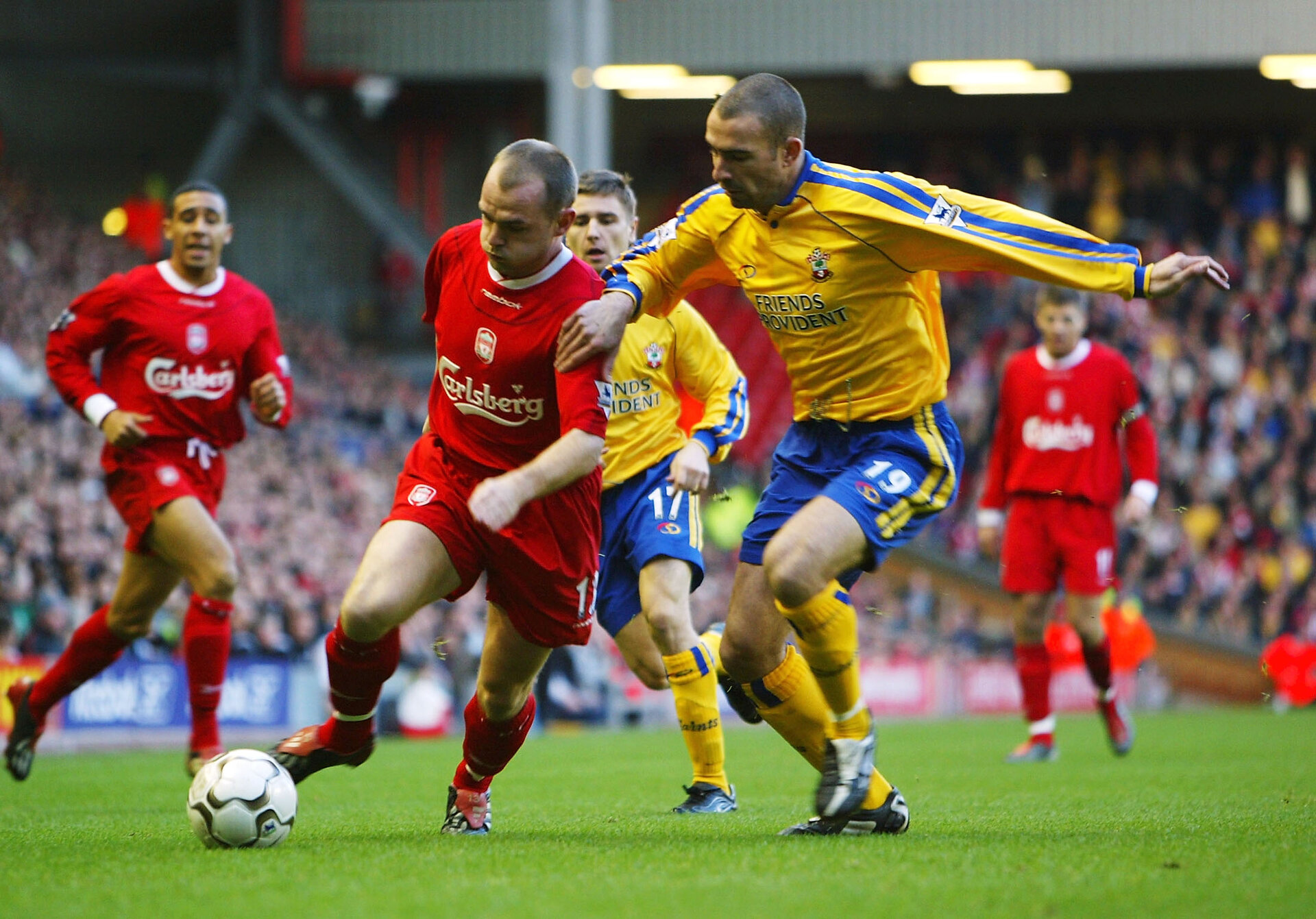 LIVERPOOL, ENGLAND - DECEMBER 13:  Danny Murphy of Liverpool holds off Paul Telfer of Southampton during the FA Barclaycard Premiership match between Liverpool and Southampton at Anfield on December 13, 2003 in Liverpool, England.  (Photo by Gary M.Prior/Getty Images)