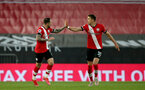 SOUTHAMPTON, ENGLAND - MAY 11: Danny Ings (L) of Southampton celebrates equalizing withJan Bednarek (R) of Southampton  during the Premier League match between Southampton and Crystal Palace at St Mary's Stadium on May 11, 2021 in Southampton, England. Sporting stadiums around the UK remain under strict restrictions due to the Coronavirus Pandemic as Government social distancing laws prohibit fans inside venues resulting in games being played behind closed doors.  (Photo by Matt Watson/Southampton FC via Getty Images)