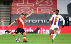 SOUTHAMPTON, ENGLAND - MAY 11: James Ward-Prowse(L) of Southampton and Wilfried Zaha (R) of Crystal Palace during the Premier League match between Southampton and Crystal Palace at St Mary's Stadium on May 11, 2021 in Southampton, England. Sporting stadiums around the UK remain under strict restrictions due to the Coronavirus Pandemic as Government social distancing laws prohibit fans inside venues resulting in games being played behind closed doors.  (Photo by Matt Watson/Southampton FC via Getty Images)