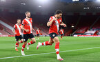 SOUTHAMPTON, ENGLAND - MAY 11: Ché Adams of Southampton goal celebration during the Premier League match between Southampton and Crystal Palace at St Mary's Stadium on May 11, 2021 in Southampton, England. Sporting stadiums around the UK remain under strict restrictions due to the Coronavirus Pandemic as Government social distancing laws prohibit fans inside venues resulting in games being played behind closed doors.  (Photo by Matt Watson/Southampton FC via Getty Images)