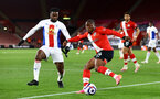 SOUTHAMPTON, ENGLAND - MAY 11: Jean-Phillippe Mateta (L) Crystal Palace and Michael Obafemi (R) of Southampton during the Premier League match between Southampton and Crystal Palace at St Mary's Stadium on May 11, 2021 in Southampton, England. Sporting stadiums around the UK remain under strict restrictions due to the Coronavirus Pandemic as Government social distancing laws prohibit fans inside venues resulting in games being played behind closed doors.  (Photo by Matt Watson/Southampton FC via Getty Images)