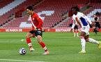 SOUTHAMPTON, ENGLAND - MAY 11: Takumi Minamino(L) of Southampton during the Premier League match between Southampton and Crystal Palace at St Mary's Stadium on May 11, 2021 in Southampton, England. Sporting stadiums around the UK remain under strict restrictions due to the Coronavirus Pandemic as Government social distancing laws prohibit fans inside venues resulting in games being played behind closed doors.  (Photo by Matt Watson/Southampton FC via Getty Images)