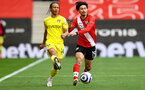 SOUTHAMPTON, ENGLAND - MAY 15: Bobby De Cordova-Reid(L) of Fulham and Takumi Minamino(R) of Southampton during the Premier League match between Southampton and Fulham at St Mary's Stadium on May 15, 2021 in Southampton, England. Sporting stadiums around the UK remain under strict restrictions due to the Coronavirus Pandemic as Government social distancing laws prohibit fans inside venues resulting in games being played behind closed doors.  (Photo by Matt Watson/Southampton FC via Getty Images)
