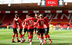 SOUTHAMPTON, ENGLAND - MAY 15: Nathan Tella of Southampton celebrates scoring with his team mates during the Premier League match between Southampton and Fulham at St Mary's Stadium on May 15, 2021 in Southampton, England. Sporting stadiums around the UK remain under strict restrictions due to the Coronavirus Pandemic as Government social distancing laws prohibit fans inside venues resulting in games being played behind closed doors.  (Photo by Matt Watson/Southampton FC via Getty Images)