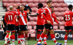SOUTHAMPTON, ENGLAND - MAY 15: Theo Walcott of Southampton celebrates scoring with his team mates during the Premier League match between Southampton and Fulham at St Mary's Stadium on May 15, 2021 in Southampton, England. Sporting stadiums around the UK remain under strict restrictions due to the Coronavirus Pandemic as Government social distancing laws prohibit fans inside venues resulting in games being played behind closed doors.  (Photo by Matt Watson/Southampton FC via Getty Images)