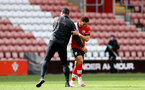 SOUTHAMPTON, ENGLAND - MAY 15: Ralph Hasenhuttl(L) and Ché Adams(R) of Southampton during the Premier League match between Southampton and Fulham at St Mary's Stadium on May 15, 2021 in Southampton, England. Sporting stadiums around the UK remain under strict restrictions due to the Coronavirus Pandemic as Government social distancing laws prohibit fans inside venues resulting in games being played behind closed doors.  (Photo by Matt Watson/Southampton FC via Getty Images)
