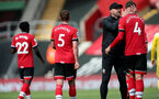 SOUTHAMPTON, ENGLAND - MAY 15: Ralph Hasenhuttl and Jannik Vestergaard(R) of Southampton during the Premier League match between Southampton and Fulham at St Mary's Stadium on May 15, 2021 in Southampton, England. Sporting stadiums around the UK remain under strict restrictions due to the Coronavirus Pandemic as Government social distancing laws prohibit fans inside venues resulting in games being played behind closed doors.  (Photo by Matt Watson/Southampton FC via Getty Images)