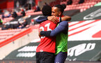SOUTHAMPTON, ENGLAND - MAY 15: Nathan Tella(L) of celebrates with Theo Walcott during the Premier League match between Southampton and Fulham at St Mary's Stadium on May 15, 2021 in Southampton, England. Sporting stadiums around the UK remain under strict restrictions due to the Coronavirus Pandemic as Government social distancing laws prohibit fans inside venues resulting in games being played behind closed doors.  (Photo by Matt Watson/Southampton FC via Getty Images)