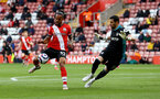 SOUTHAMPTON, ENGLAND - MAY 18: Theo Walcott(L) of Southampton and Kiko Casilla(R) of Leeds during the Premier League match between Southampton and Leeds United at St Mary's Stadium on May 18, 2021 in Southampton, England. (Photo by Matt Watson/Southampton FC via Getty Images)