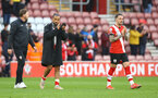 SOUTHAMPTON, ENGLAND - MAY 18: L to R Southampton manager Ralph Hasenhüttl, Theo Walcott and Danny Ings of during the Premier League match between Southampton and Leeds United at St Mary's Stadium on May 18, 2021 in Southampton, England. (Photo by Matt Watson/Southampton FC via Getty Images)