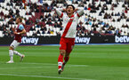 LONDON, ENGLAND - MAY 23: Takumi Minamino of Southampton reacts after shooting wide during the Premier League match between West Ham United and Southampton at London Stadium on May 23, 2021 in London, England. (Photo by Matt Watson/Southampton FC via Getty Images)