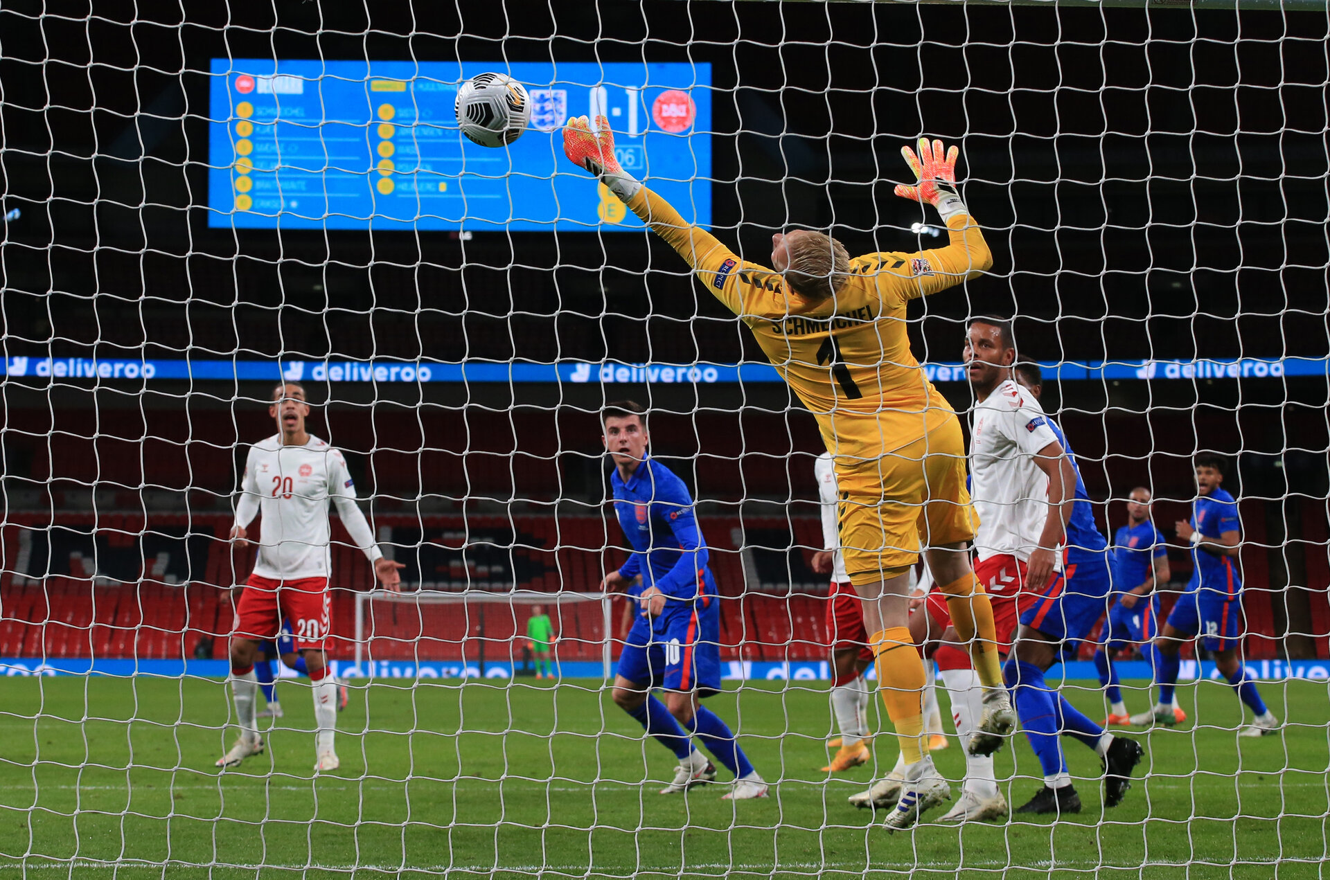 LONDON, ENGLAND - OCTOBER 14: Mason Mount of England heads the ball but is saved by Kasper Schmeichel of Denmark  during the UEFA Nations League group stage match between England and Denmark at Wembley Stadium on October 14, 2020 in London, England. Football Stadiums around Europe remain empty due to the Coronavirus Pandemic as Government social distancing laws prohibit fans inside venues resulting in fixtures being played behind closed doors. (Photo by Nick Potts - Pool/Getty Images)