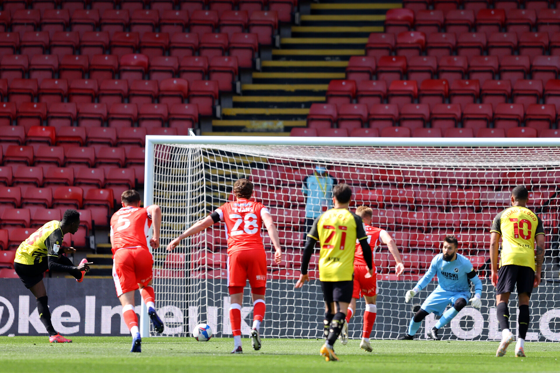 WATFORD, ENGLAND - APRIL 24: Ismaila Sarr of Watford scores their sides first goal from the penalty spot past Bartosz Bialkowski of Millwall  during the Sky Bet Championship match between Watford and Millwall at Vicarage Road on April 24, 2021 in Watford, England. Sporting stadiums around the UK remain under strict restrictions due to the Coronavirus Pandemic as Government social distancing laws prohibit fans inside venues resulting in games being played behind closed doors.  (Photo by Richard Heathcote/Getty Images)