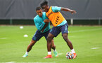SOUTHAMPTON, ENGLAND - JULY 08: Yan Valery(L) and Mohammed Salisu during a Southampton FC pre season training session at the Staplewood Campus on July 08, 2021 in Southampton, England. (Photo by Matt Watson/Southampton FC via Getty Images)