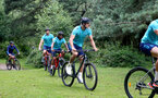 SOUTHAMPTON, ENGLAND - JULY 15: Alex McCarthy(R) during team building cycle ride around Deerleap, New Forest on July 15, 2021 in Southampton, England. (Photo by Isabelle Field/Southampton FC via Getty Images)