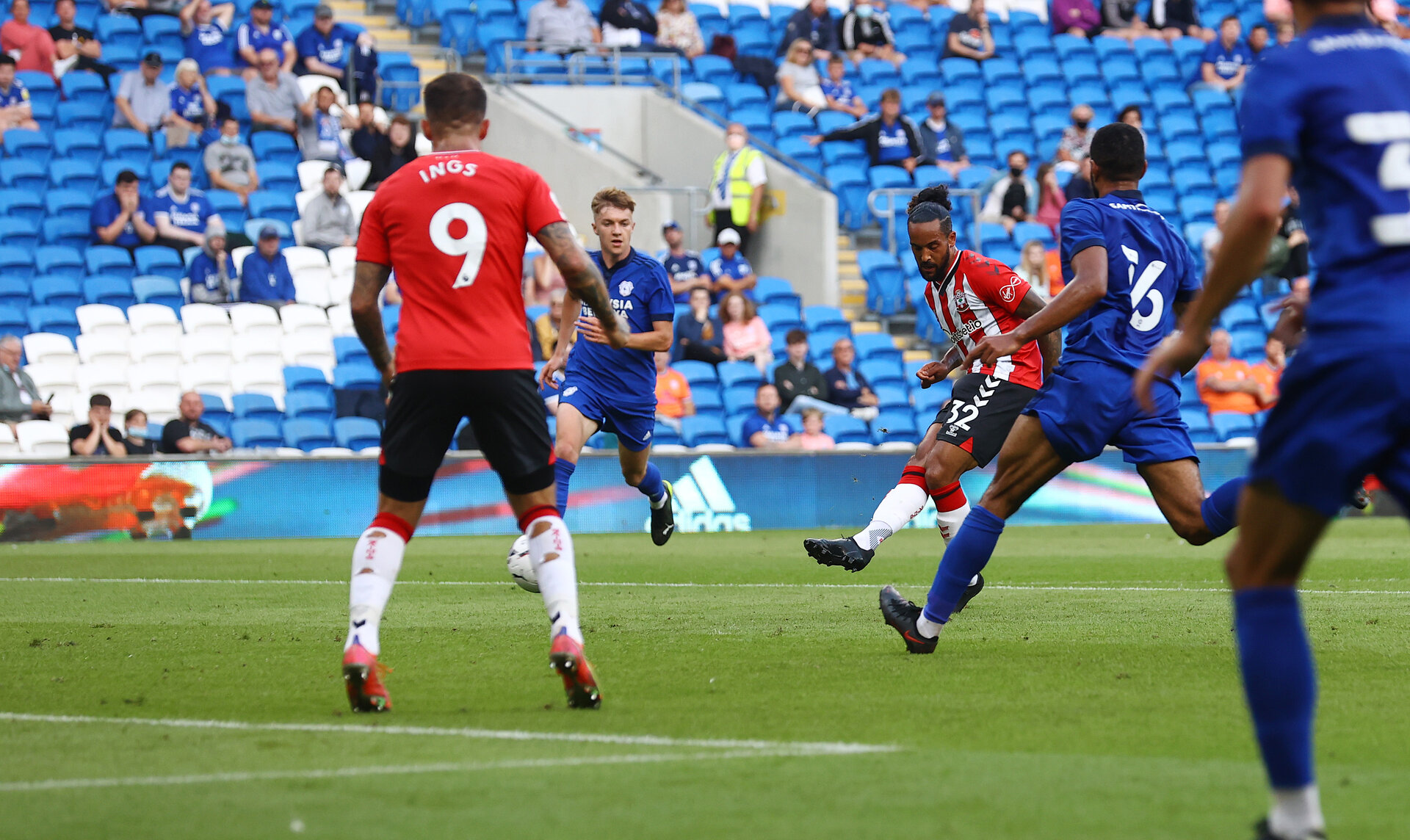 CARDIFF, WALES - JULY 27: Theo Walcott of Southampton scores the opening goal during the Pre-Season Friendly match between Cardiff City and Southampton at Cardiff City Stadium on July 27, 2021 in Cardiff, Wales. Photo by Matt Watson/Southampton FC via Getty Images