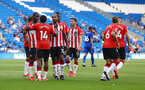 CARDIFF, WALES - JULY 27: Theo Walcott(centre) of Southampton is congratulated by his team mates after scoring during the Pre-Season Friendly match between Cardiff City and Southampton at Cardiff City Stadium on July 27, 2021 in Cardiff, Wales. Photo by Matt Watson/Southampton FC via Getty Images