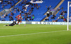CARDIFF, WALES - JULY 27: Che Adams of Southampton rounds the keeper to score during the Pre-Season Friendly match between Cardiff City and Southampton at Cardiff City Stadium on July 27, 2021 in Cardiff, Wales. Photo by Matt Watson/Southampton FC via Getty Images