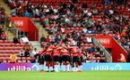 SOUTHAMPTON, ENGLAND - AUGUST 07: Saints players huddle before kick off during the pre season friendly match between Southampton FC and Athletic Club at St Mary's Stadium on August 07, 2021 in Southampton, England. (Photo by Matt Watson/Southampton FC via Getty Images)