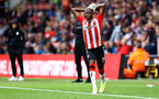 SOUTHAMPTON, ENGLAND - AUGUST 07: Moussa Djenepo of takes a throw in during the pre season friendly match between Southampton FC and Athletic Club at St Mary's Stadium on August 07, 2021 in Southampton, England. (Photo by Matt Watson/Southampton FC via Getty Images)