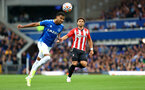 LIVERPOOL, ENGLAND - AUGUST 14: Mason Holgate(L) of Everton and Che Adams(R) of Southampton during the Premier League match between Everton  and  Southampton at Goodison Park on August 14, 2021 in Liverpool, England. (Photo by Matt Watson/Southampton FC via Getty Images)
