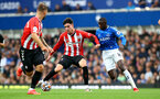 LIVERPOOL, ENGLAND - AUGUST 14: Tino Livramento(center) of Southampton and Abdoulaye Doucoure(R) of Everton during the Premier League match between Everton  and  Southampton at Goodison Park on August 14, 2021 in Liverpool, England. (Photo by Matt Watson/Southampton FC via Getty Images)