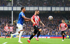 LIVERPOOL, ENGLAND - AUGUST 14: Mason Holgate(L) of Everton and Adam Armstrong(R) of Southamptonduring the Premier League match between Everton  and  Southampton at Goodison Park on August 14, 2021 in Liverpool, England. (Photo by Matt Watson/Southampton FC via Getty Images)