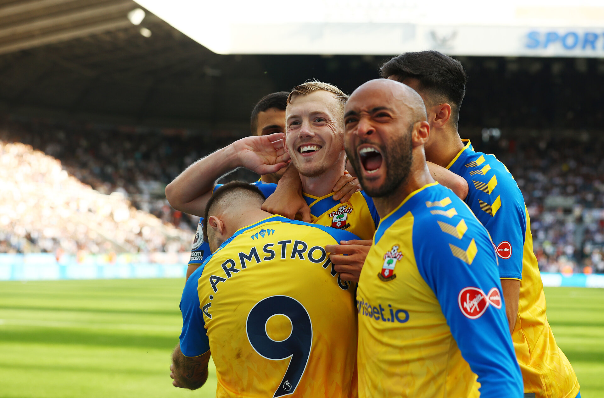 NEWCASTLE UPON TYNE, ENGLAND - AUGUST 28: James Ward-Prowse celebrates with his team mates including Nathan Redmond(R) during the Premier League match between Newcastle United  and  Southampton at St. James Park on August 28, 2021 in Newcastle upon Tyne, England. (Photo by Matt Watson/Southampton FC via Getty Images)