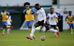 SURREY, ENGLAND - SEPTEMBER 10: Kamari Doyle(L) of Southampton during Premier League 2, Division 2 match between Fulham and Southampton B Team at Fulham FC Training Ground on September 10, 2021 in Surrey, England. (Photo by Isabelle Field/Southampton FC via Getty Images)