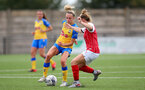 CHELTENHAM, ENGLAND - SEPTEMBER 12: Phoebe Williams(L) of Southampton during the Women's FA National League Cup match between  Cheltenham Town and  Southampton Women at The Corinium Stadium on September 12, 2021 in  Cheltenham, England. (Photo by Isabelle Field/Southampton FC via Getty Images)