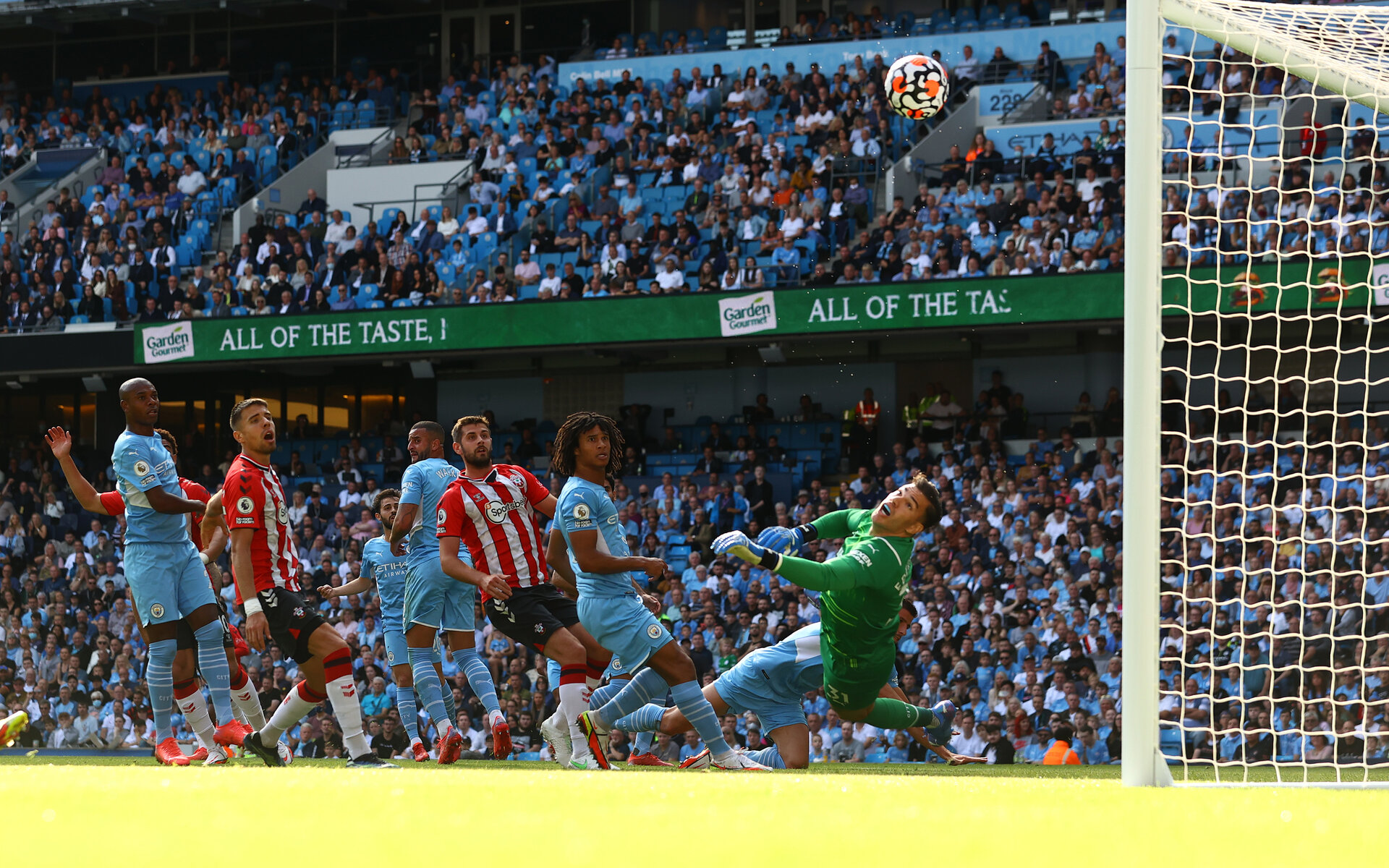 MANCHESTER, ENGLAND - SEPTEMBER 18: Ederson of Manchester City pushes the ball onto the post during the Premier League match between Manchester City and Southampton at Etihad Stadium on September 18, 2021 in Manchester, England. (Photo by Matt Watson/Southampton FC via Getty Images)
