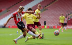 SOUTHAMPTON, ENGLAND - SEPTEMBER 19: Dominic Ballard (L) of Southampton during the Premier League 2 match between Southampton B Team and Burnley at St Mary's Stadium on September 19, 2021 in Southampton, England. (Photo by Isabelle Field/Southampton FC via Getty Images)