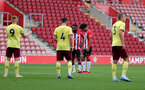 SOUTHAMPTON, ENGLAND - SEPTEMBER 19: Kazeem Olaigbe(L) of Southampton and Kamari Doyle(R) of Southampton during the Premier League 2 match between Southampton B Team and Burnley at St Mary's Stadium on September 19, 2021 in Southampton, England. (Photo by Isabelle Field/Southampton FC via Getty Images)