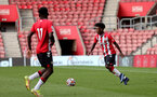 SOUTHAMPTON, ENGLAND - SEPTEMBER 19: Joshua Lett(R) of Southampton during the Premier League 2 match between Southampton B Team and Burnley at St Mary's Stadium on September 19, 2021 in Southampton, England. (Photo by Isabelle Field/Southampton FC via Getty Images)