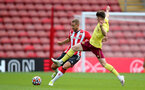 SOUTHAMPTON, ENGLAND - SEPTEMBER 19: Olly Lancashire(L) of Southampton during the Premier League 2 match between Southampton B Team and Burnley at St Mary's Stadium on September 19, 2021 in Southampton, England. (Photo by Isabelle Field/Southampton FC via Getty Images)