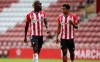 SOUTHAMPTON, ENGLAND - SEPTEMBER 19: Dynel Simeu(L) and Caleb Watts(R) of Southampton during the Premier League 2 match between Southampton B Team and Burnley at St Mary's Stadium on September 19, 2021 in Southampton, England. (Photo by Isabelle Field/Southampton FC via Getty Images)