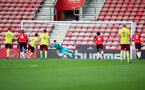 SOUTHAMPTON, ENGLAND - SEPTEMBER 19: Oliver Wright of Southampton saves penalty during the Premier League 2 match between Southampton B Team and Burnley at St Mary's Stadium on September 19, 2021 in Southampton, England. (Photo by Isabelle Field/Southampton FC via Getty Images)