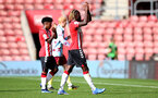 SOUTHAMPTON, ENGLAND - SEPTEMBER 19: Joshua Lett(L) of Southampton and Dynel Simeu(R) of Southampton during the Premier League 2 match between Southampton B Team and Burnley at St Mary's Stadium on September 19, 2021 in Southampton, England. (Photo by Isabelle Field/Southampton FC via Getty Images)