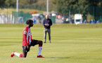 BIRMINGHAM, ENGLAND - SEPTEMBER 27: Kegs Chauke of Southampton takes the knee in support of the Black Lives Matter movement during the Premier League 2 match between Birmingham City and Southampton B Team at Wast Hills Training Ground on September 27, 2021 in Birmingham , England. (Photo by Isabelle Field/Southampton FC via Getty Images)