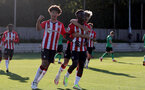 SOUTHAMPTON, ENGLAND - OCTOBER 01: Kazeem Olaigbe(L) of Southampton and Dominic Ballard(R) of Southampton celebrate with Kazeem Olaigbe(center) after he scores a penalty during the Premier League 2 match between Southampton B Team and Stoke City at Staplewood Training Ground on October 01, 2021 in Southampton, England. (Photo by Isabelle Field/Southampton FC via Getty Images)